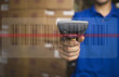 Hispanic man scanning barcode in warehouse