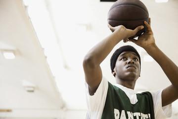 African basketball player shooting ball