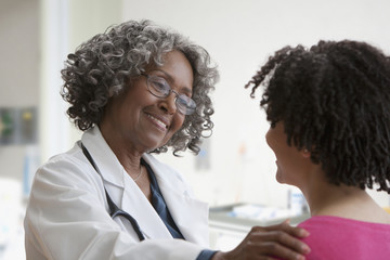 African doctor greeting patient