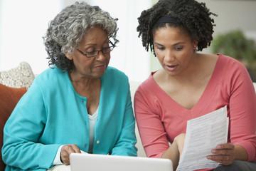 African women looking at paperwork