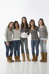 Teenage girls wearing matching clothing