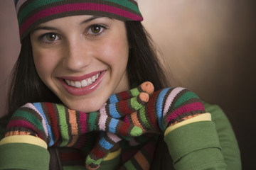 Mixed race teenage girl wearing striped gloves