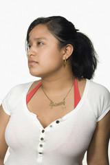 Hispanic woman looking pensive
