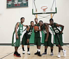 African basketball players in gym
