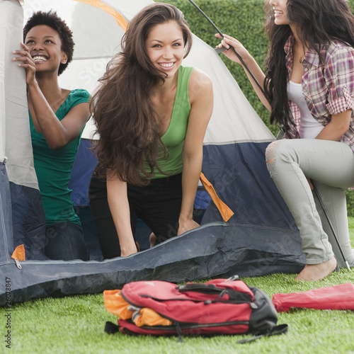 Friends putting  up tent