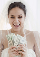 Bride holding handful of money