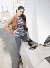 Mixed race woman having car trouble