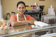 Hispanic woman working in coffee shop