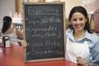 Hispanic woman working in cafe