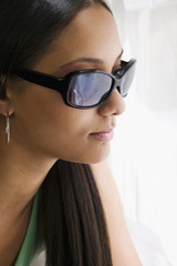 Close up of mixed race woman in sunglasses