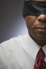 African businessman in blindfold