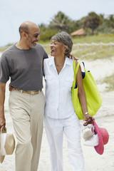African couple walking on beach