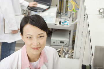 Chinese scientist in laboratory smiling