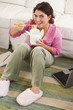 Mixed race woman eating take-out