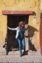 Hispanic woman standing in doorway
