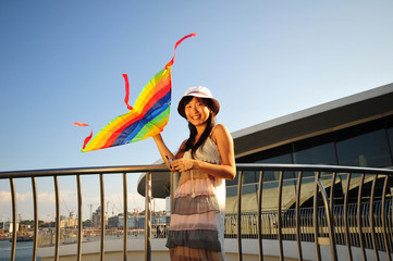 Asian Girl with kite under the sun