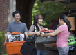 Chinese parents helping daughter load car for college