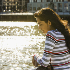 Hispanic woman standing at waterfront