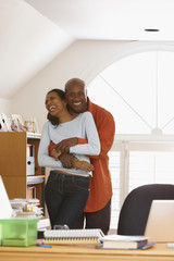 Black couple working in home office
