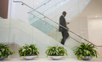 African American businessman descending staircase