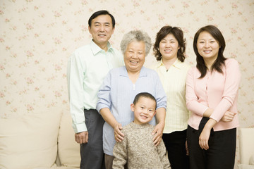 Chinese multi-generational family smiling