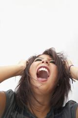 Hispanic teenage girl shouting