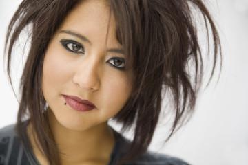 Hispanic teenage girl with wild hairstyle
