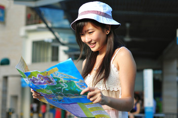 Little Chinese Asian Tourist Girl looking at her map