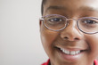 Hispanic boy in eyeglasses smiling