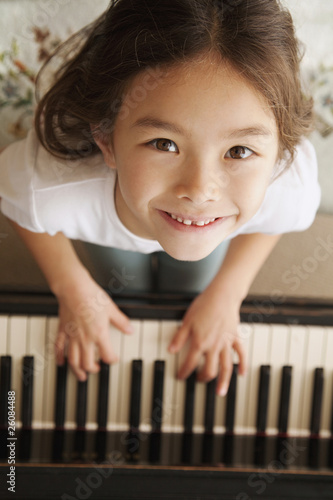 Mixed race girl playing piano