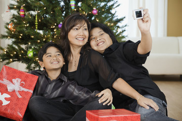 Filipino family taking self-portrait at Christmas