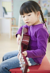 Chinese girl playing guitar