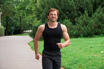 Portrait of a man running in park