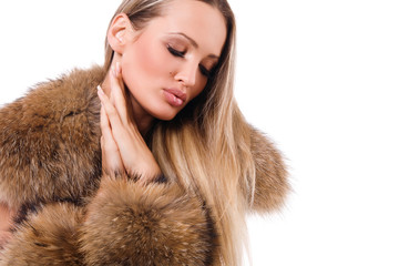 Beautiful young woman in fur