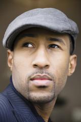 African American man wearing cap
