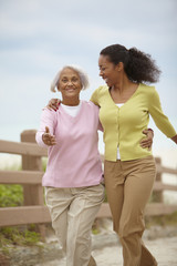 African American woman walking with mother