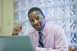 African American businessman sitting at desk