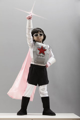 Korean girl in superhero costume with arm raised