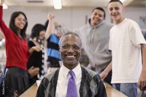 Librarian with cheering students in school library
