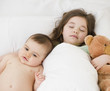 Mixed race girl sleeping with baby brother