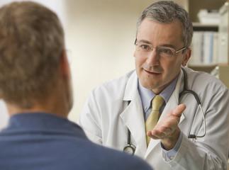 Doctor talking to patient in doctorÕs office