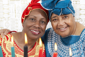 African American mother and daughter in traditional clothing