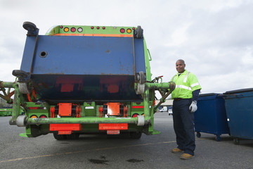Black man operating garbage truck