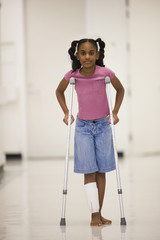 African American girl walking on crutches
