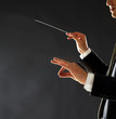 Music conductor - Man directing with his baton in concert