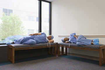 Surgeons napping in hospital waiting room