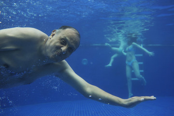 Hispanic man swimming underwater