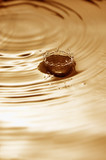 Splash and droplet with water ripples