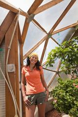 Ecuadorian woman posing in greenhouse