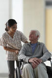 Nurse pushing senior man in wheelchair